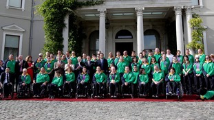 Members of Ireland's Paralympic team pose for a group picture alongside government officials.