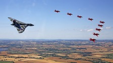 The Vulcan and Red Arrows in clear skies over Fairford