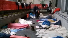 Migrants sleeping on concrete floors