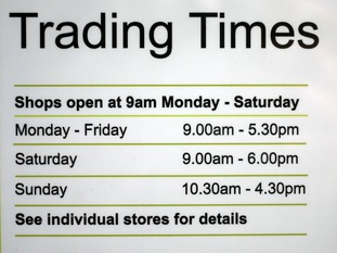 A sign on Elmsleigh shopping centre in Staines-upon-Thames, Surrey, telling customers of their Sunday opening times