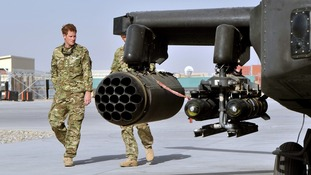 Prince Harry is shown the Apache flight-line by a member of his squadron on his arrival in Afghanistan.