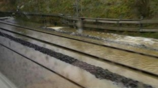 Flooding and signalling problems have been blamed for delays.