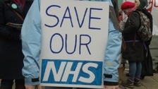 A poster held by a doctor outside the Bristol Royal Infirmary this morning.