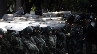 Eggs thrown by demonstrators splatter onto police shields during a protest outside the Japanese embassy in Beijing