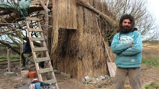 Man being evicted from self-made straw house on banks of the Severn