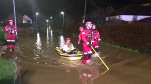 Firefighters were called to help residents stuck in homes.
