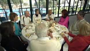 Pensioners round a table
