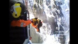 WATCH: Dramatic rescue of couple cut off by tide in Cornwall