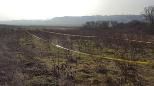 The grim discovery was made in woodland near a disused runway.