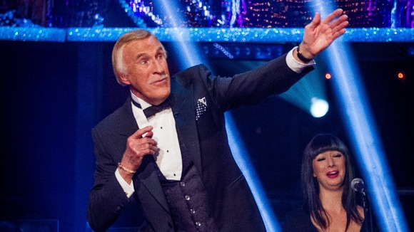 Bruce Forsyth does a Usain Bolt pose
