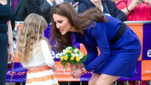 Duchess of Cambridge being presented with flowers by Tilly Jenning during her visit to the Treehouse, part of the East Anglia's Children's Hospices, in Ipswich in March 2012.