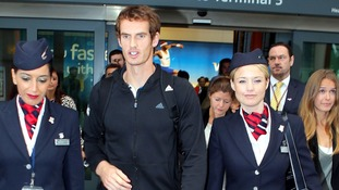 Andy Murray pictured arriving in London after his US Open victory on Wednesday.