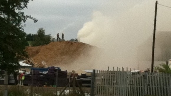Firefighters working to control the fire at the recycling plant in Stanton-by-Dale