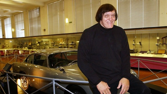Richard Kiel, who played &#x27;Jaws&#x27; in James Bond movies, poses with an Aston Martin 