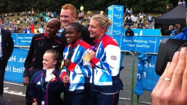 Team GB stars show off their medals at the start line.