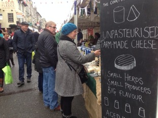 People at a cheese stall in Kendal