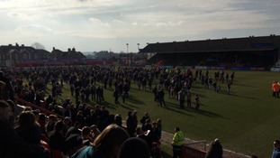 Fans evacuated onto the pitch