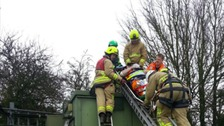 Firefighters rescue the man who had fallen 20m.
