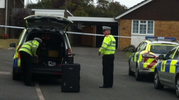 Officers arrive to analyse the scene in East Sussex.