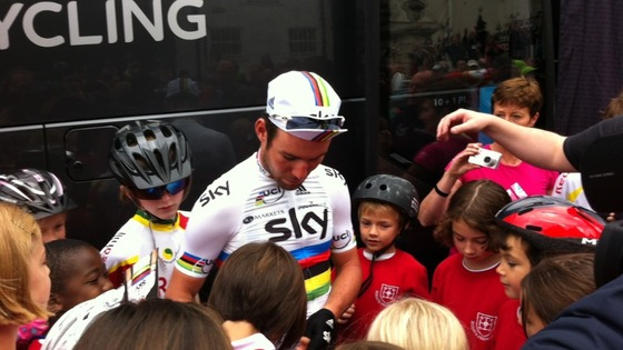 Cyclist Mark Cavendish meets pupils from Reigate Priory Junior School.