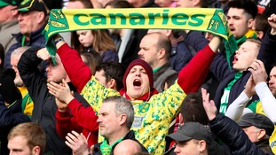 Canaries fans get behind the team at Saturday's match against Manchester City.