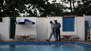 Security officers examine a hotel after an attack in Grand Bassam, Ivory Coast