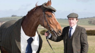 Sir Tony McCoy and Morestead wearing matching tweed