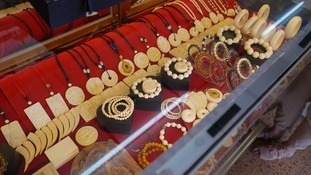 Ivory jewellery displayed in a cabinet