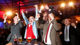 Supporters of anti-immigration Alternative for Germany (AFD) celebrate following first exit polls in the state election in Baden-Wuerttemberg