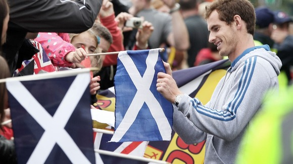 Andy Murray sign flags and autographs for his adoring fans