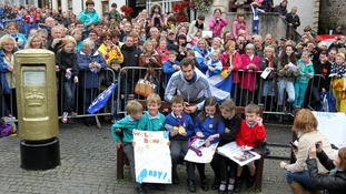 Local school children meet their hero