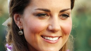 The Duchess of Cambridge smiles for the cameras.