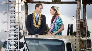 The Royal couple travel on an open-topped Toyota van decorated to look like a fearsome war vessel.