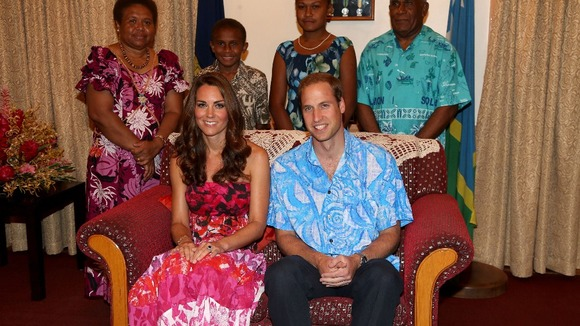 The Duke and Duchess of Cambridge pose in traditional Island clothing with the Governor General Frank Kabui's family