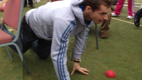 Andy Murray plays with kids at Dunblane tennis club