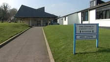 Exterior of King Edward VI Community College in Totnes with sign