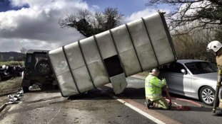 'Miraculous escape' after sheep trailer ends up on top of car