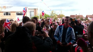 Hundreds welcome gold-medal winning swimmer Josef Craig back to school