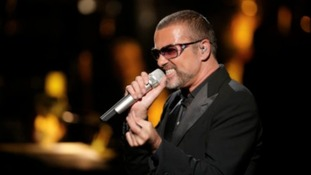 George Michael performs at a charity concert