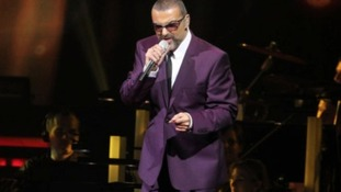 George Michael performs during his 'Symphonica' tour in Vienna