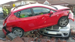 Hospital car park crash leaves car on top of 4×4