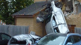 Car crashes into house.