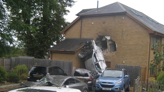 Car crashes into house.