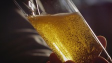 close up pint of beer pouring