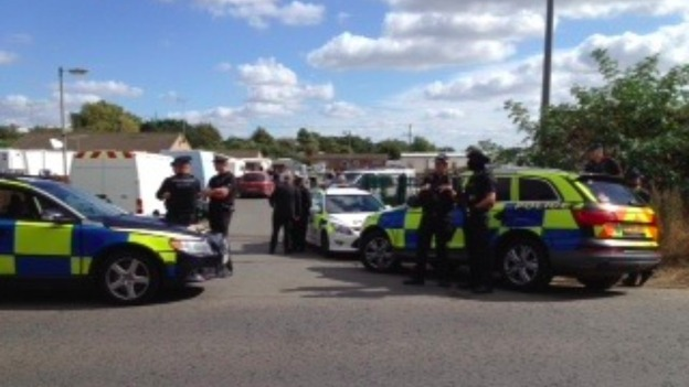 Police outside the Oxney Road travellers' site on the outskirts of Peterborough.