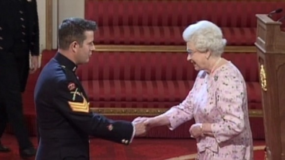 Warrant Officer Kim Hughes receives George Cross from Her Majesty the Queen