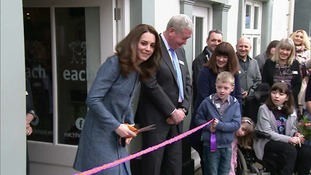 The Duchess cuts the ribbon to open new shop