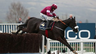 Don Cossack ridden by Bryan Cooper on the way to winning the Timico Cheltenham Gold Cup Chase