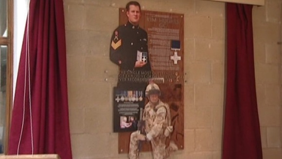 The plaque unveiled at Warrant Officer Kim Hughes' old school
