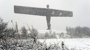 The Angel of the North statue is covered in heavy snow